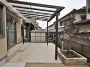 施工後:タイルテラスと屋根で明るく実用的なお庭 - 大阪府高槻市K様邸